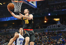 December 6, 2017 - Orlando, FL, USA - Atlanta Hawks center Miles Plumlee (18) goes for the layup -- <br />The Orlando Magic hots the Atlanta Hawks at Amway Center, on Wednesday, December 6, 2017.<br />With 8:00 left on the second quarter, the Magic were ahead, 35-29. (Credit Image: © Ricardo Ramirez Buxeda/TNS via ZUMA Wire)
