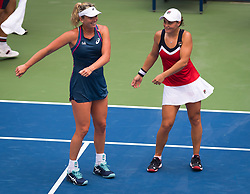 September 4, 2018 - New York, New York, U.S. -  Ashleigh Barty of Australia & Coco Vandeweghe of the United States dance during doubles at the 2018 US Open Grand Slam tennis tournament. New York. (Credit Image: © AFP7 via ZUMA Wire)