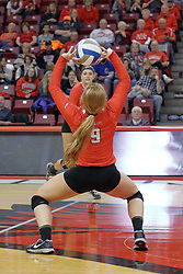 17 October 2015:  Jacqueline Twing(9) squats to set the ball for a striker during an NCAA women's volleyball match between the Southern Illinois Salukis and the Illinois State Redbirds at Redbird Arena in Normal IL (Photo by Alan Look)
