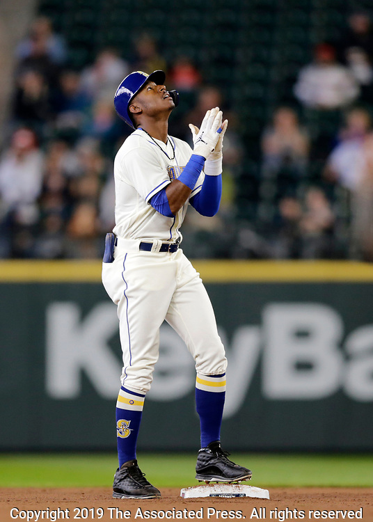 Seattle Mariners' Kyle Lewis reacts on second after hitting a double against the Chicago White Sox during the fourth inning of a baseball game, Sunday, Sept. 15, 2019, in Seattle. He went on to score in the inning, (AP Photo/John Froschauer)