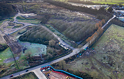VIDEO AVAILABLE : https://we.tl/t-SQVmqbvcNl © Licensed to London News Pictures. 29/01/2020. London, UK. A protest camp (R) marks the route of the High Speed Two (HS2) rail line near Newyears Green Covert a woodland area in the London Borough of Hillingdon.  A government decision is expected soon on whether the HS2 rail project will fully go ahead with some budget estimates showing a cost of £70-£80bn. Photo credit: Peter Macdiarmid/LNP