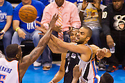 June 2, 2012; Oklahoma City, OK, USA; Oklahoma City Thunder center Kendrick Perkins (5) attempts to block a shot by San Antonio Spurs guard Tony Parker (9) during a playoff game  at Chesapeake Energy Arena.  Thunder defeated the Spurs 109-103 Mandatory Credit: Beth Hall-US PRESSWIRE