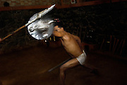 Participants compete at Kalarippayat, a game of combat skills with swords and shields, Cochin, Kerala, India