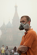 Moscow, Russia, 07/08/2010. .A man wears an industrial gas mask in Red Square in the worst smog so far in the record high temperatures of the continuing heatwave. Peat and forest fires in the countryside surrounding Moscow have resulted in the Russian capital being blanketed in heavy smog.