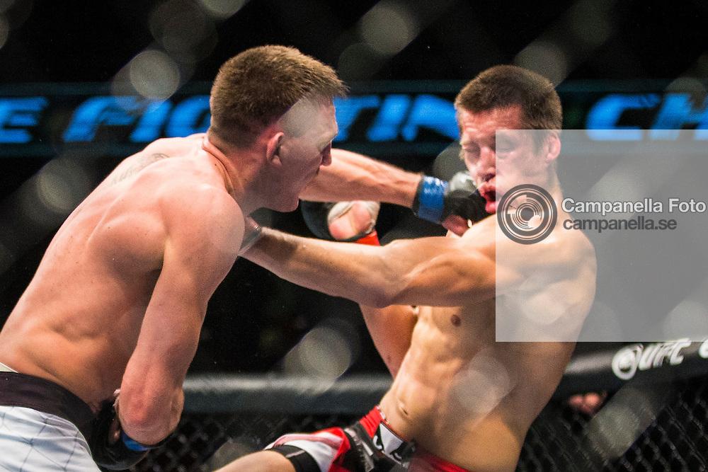 Stockholm 2014-10-04:  <br /> <br /> Scott Askham hits Magnus Cedenblad with a hard punch at UFC Fight Night on October 4th, 2014 in Stockholm, Sweden.<br /> <br /> (Photo: Michael Campanella / Pic-Agency)