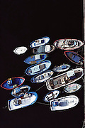 Fishing boats in the harbor at Barcelona, Spain, seen from above.