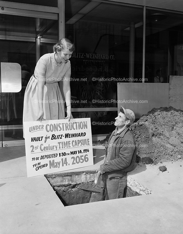 """Y-560511-02.  digging hole for Blitz time capsule. """"Under Construction. Vault for Blitz Weinhard 2nd Century Time Capsule. To be deposited 1:30 PM May 14, 1956. To be opened May 14, 2056."""""""
