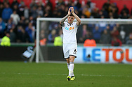 Alfie Mawson of Swansea city applauds the fans at the end of the game.  Premier league match, Swansea city v Leicester city at the Liberty Stadium in Swansea, South Wales on Saturday 21st October 2017.<br /> pic by  Andrew Orchard, Andrew Orchard sports photography.