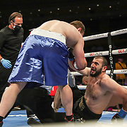 HOLLYWOOD, FL - APRIL 17:  Andrey Fedosov walks over to an injured Mahammadrasul Majidov at Seminole Hard Rock Hotel & Casino on April 17, 2021 in Hollywood, Florida. (Photo by Alex Menendez/Getty Images) *** Local Caption *** Mahammadrasul Majidov; Andrey Fedosov