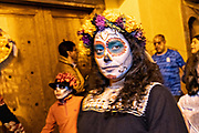 A Mexican girl wearing skeleton face paint during the Dead of the Dead festival in San Miguel de Allende, Mexico. The multi-day festival is to remember friends and family members who have died using calaveras, aztec marigolds, alfeniques, papel picado and the favorite foods and beverages of the departed.