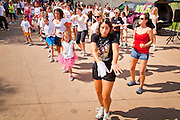 """30 JULY 2011 - PHOENIX, AZ:   Girls dance to Michael Jackson's """"Thriller"""" in a flash mob in downtown Phoenix, AZ, Saturday. About 200 people showed up at Heritage Square in downtown Phoenix Saturday morning for a flash mob coordinated by the Arizona Science Center. The mob danced to several hip-hop songs before disbanding. The event was a part of National Dance Day Activities and the First Lady's """"Let's Move!"""" physical fitness campaign.  PHOTO BY JACK KURTZ"""