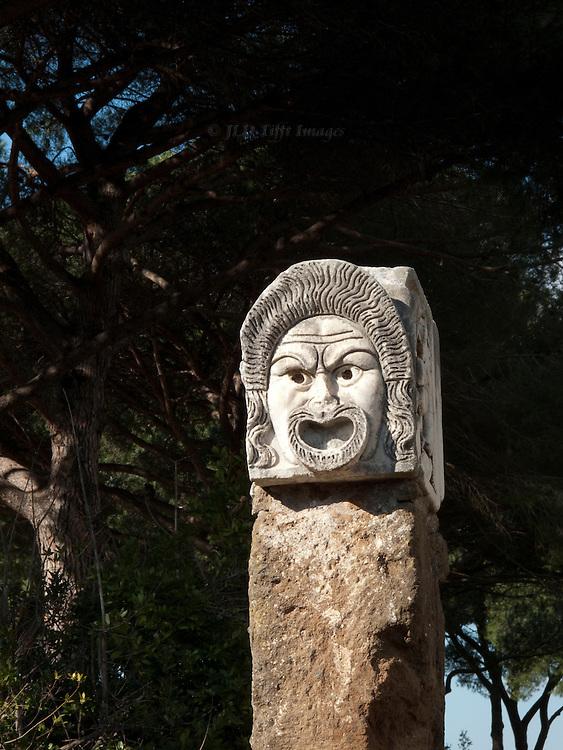 Ostia Antica. Closeup of a theatrical mask carved in stone.
