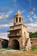 """picture & image of the gate and bell tower of the Samtavisi Georgian Orthodox Cathedral, 11th century, Shida Karti Region, Georgia (country)<br /> <br /> Built during the so called 10-11th century """"Georgian Golden Era"""" Samtavisi cathedral is a built in classical Georgian style of the period. Layout on a cruciform ground plan with a high central cylindrical central cupola. .<br /> <br /> Visit our MEDIEVAL PHOTO COLLECTIONS for more   photos  to download or buy as prints https://funkystock.photoshelter.com/gallery-collection/Medieval-Middle-Ages-Historic-Places-Arcaeological-Sites-Pictures-Images-of/C0000B5ZA54_WD0s<br /> <br /> Visit our REPUBLIC of GEORGIA HISTORIC PLACES PHOTO COLLECTIONS for more photos to browse, download or buy as wall art prints https://funkystock.photoshelter.com/gallery-collection/Pictures-Images-of-Georgia-Country-Historic-Landmark-Places-Museum-Antiquities/C0000c1oD9eVkh9c"""
