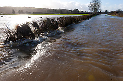 © Licensed to London News Pictures. 19/12/2020. Whitney-on-Wye, Herefordshire, UK. A road is flooded at Whitney-on-Wye in Herefordshire after the river Wye breaks it's banks. Photo credit: Graham M. Lawrence/LNP