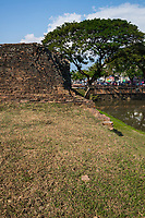 The layout of Chiang Mai was based on old military and astrological beliefs. King Mengrai ordered the construction of a perimeter wall and moat; laid in a rectangular shape.  40,000 men were engaged to construct the city walls, observation towers, city gates and city moats.  Within four months, most of the work was completed, each of the four walls had one gate with a given name, according to its location or significance in daily life.  Although the moat itself is intact, there are only ruins of walls and gates that can still be seen, after restorations and slight modifications.  The main gate or Tha Pae Gate as well as the North Chang Phuak Gates are in the best condition.