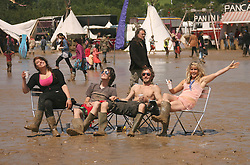 © Licensed to London News Pictures. 24/06/2012. Somerset, UK. Festival goers enjoy the mud and the sunshine at The Sunrise Festival held at Bruton In Somerset today 24 June 2012. Photo credit : Jason Bryant/LNP