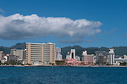 A view of Waikiki from the ocean with the Koolau Mountains in the background.