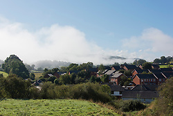 © Licensed to London News Pictures.20/09/2021. Builth Wells, Powys, Wales, UK. Autumnal morning mist hangs over Builth Wells in Powys, UK after temperatures dropped to single figures last night. Photo credit: Graham M. Lawrence/LNP