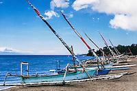 Nusa Tenggara, Lombok, Senggigi. Traditional sail vessels on West Lombok. Bali in the background with Gunung Agung.