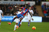 Pape Souare of Crystal Palace holds off Wayne Routledge of Swansea city.Barclays Premier league match, Swansea city v Crystal Palace at the Liberty Stadium in Swansea, South Wales on Saturday 6th February 2016.<br /> pic by Andrew Orchard, Andrew Orchard sports photography.