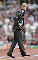 Photo: Paul Thomas.<br /> West Ham United v Arsenal. The Barclays Premiership. 24/09/2005.<br /> <br /> Arsene Wenger, not a very happy Arsenal manager.