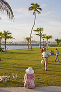 Some of Miami Beach's many dog owners gather for a new years eve walkies meeting at South Pointe Park Miami Beach