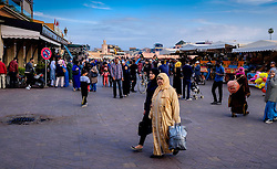 People strolling in the early evening in the Jemaa el Fna in Marrakech, Morocco, North Africa<br /> <br /> (c) Andrew Wilson | Edinburgh Elite media