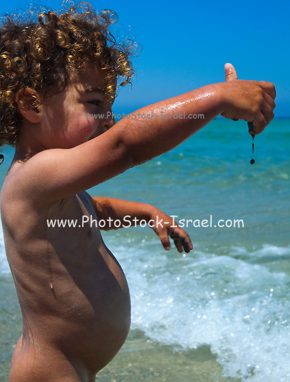 Toddler of three plays on the beach