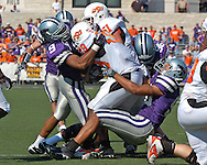The Kansas State defense stacks up Oklahoma State running back Mike Hamilton (29) in the first half at Bill Snyder Family Stadium in Manhattan, Kansas, October 7, 2006.  The Wildcats beat the Cowboys 31-27.<br />