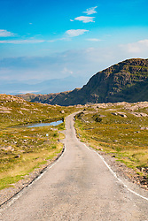 single track road at Applecross Peninsula in Scotland part of North Coast 500 tourist road trip