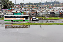South Africa - Cape Town -  13 July 2020 -Cars navigate their way throough flooded N2 near Nyanga. The cold and poor weather conditions  caused havoc across Cape Town, with various informal settlements across the city having been affected.Photographer Lubabalo Poswa African News Agency(ANA)