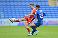 Jonathan Howson (16) of Middlesbrough battles for possession with Ryan Giles (26) of Cardiff City during the EFL Sky Bet Championship match between Cardiff City and Middlesbrough at the Cardiff City Stadium, Cardiff, Wales on 23 October 2021.