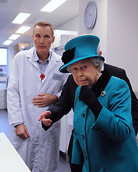 Senior scientist Greg Elgar from the Francis Crick Institute shows Queen Elizabeth II a laboratory during her visit to officially open the Francis Crick Institute in central London.
