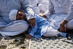 June 26, 2017 - Kolkata, India - A Muslim Kid seen resting on his father's lap while waiting for the Namaz to start on Eid al-fitr, Kolkata,India,26.6.2017. (Credit Image: © Sushavan Nandy/NurPhoto via ZUMA Press)