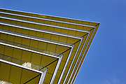 Construction of a new building. The yellow of each floor contrasts against the pure blue sky. London
