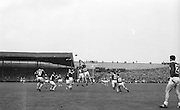 Kerry midfielder D. O'Sullivan and Galway right half forward C. Dunne jump for possession during the All Ireland Senior Gaelic Football Final Kerry v. Galway in Croke Park on the 26th September 1965. Galway 0-12 Kerry 0-09.