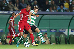 November 22, 2017 - Lisbon, Portugal - Olympiacos' Colombian midfielder Felipe Pardo (L) vies with Sporting's defender Stefan Ristovsk from Macedonia during the UEFA Champions League group D football match Sporting CP vs Olympiacos FC at Alvalade stadium in Lisbon, Portugal on November 22, 2017. Photo: Pedro Fiuza (Credit Image: © Pedro Fiuza via ZUMA Wire)