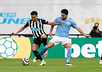 Football - 2020 / 2021 Premier League - Newcastle United vs Manchester City - St James' Park<br /> <br /> Jacob Murphy of Newcastle United vies with Ilkay Gundogan of Manchester City<br /> <br /> Credit : COLORSPORT/BRUCE WHITE