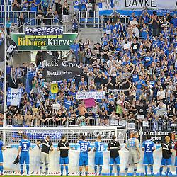 Sinsheim 28.04.12, 1.Fußball Bundesliga, TSG 1899 Hoffenheim - 1. FC Nürnberg, die Fans mit Plakaten und davor die Mannschaft<br /> <br /> Foto © Rhein-Neckar-Picture *** Foto ist honorarpflichtig! *** Auf Anfrage in hoeherer Qualitaet/Aufloesung. Belegexemplar erbeten. Veroeffentlichung ausschliesslich für journalistisch-publizistische Zwecke.