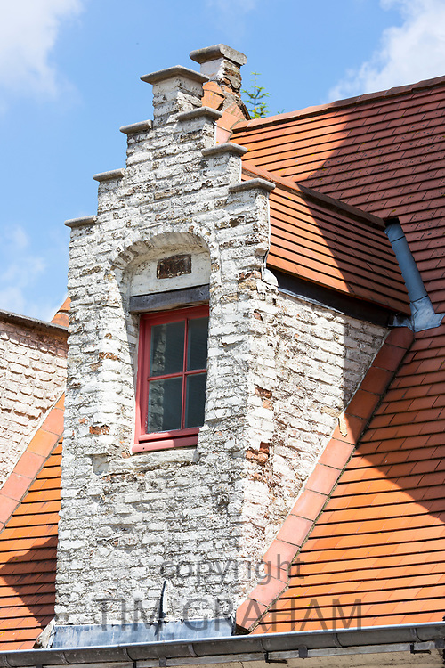 Traditional Belgian architecture crow-stepped gable (crow steps) and terracotta roof tiles in Walplein, Bruges, Belgium
