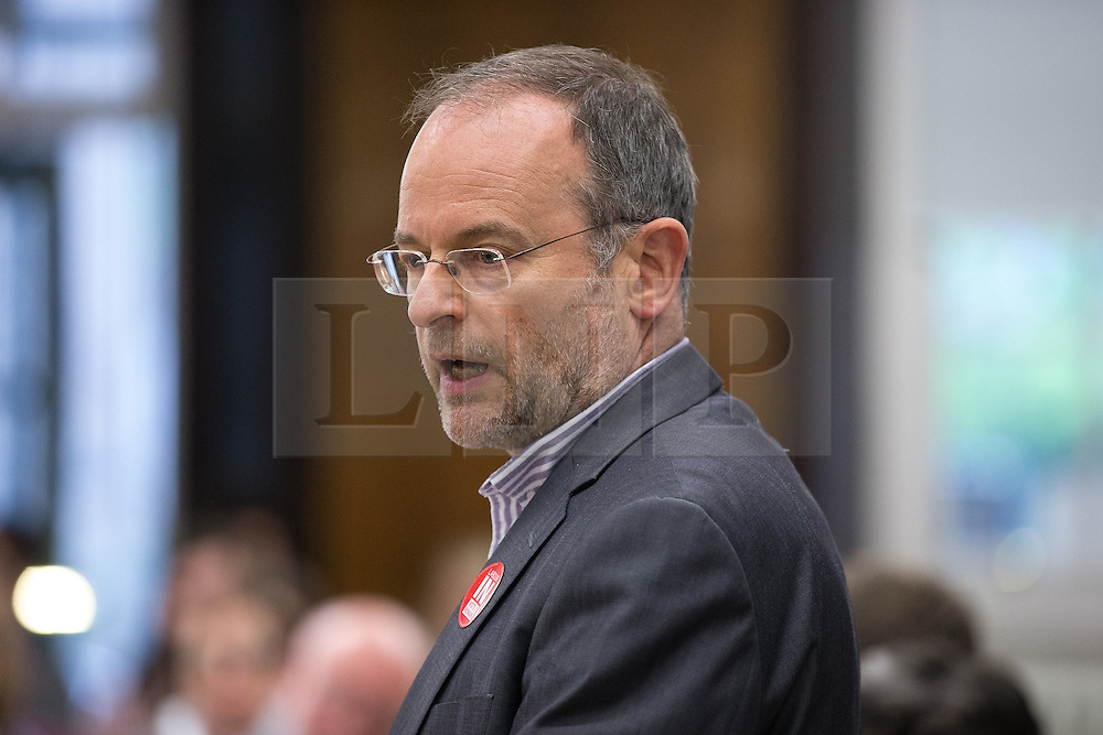 © Licensed to London News Pictures . 13/05/2016 . Sheffield , UK . PAUL BLOMFIELD MP introduces former Labour Party leader , Ed Miliband , delivers a speech in favour of the Remain in EU campaign and on the subject of climate change , at King Edward VII Upper School in Sheffield . Photo credit: Joel Goodman/LNP