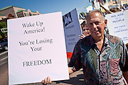 Aug. 8, 2009 -- SCOTTSDALE, AZ: RICHARD KUBIAN, from Scottsdale, and others picket the offices of Congressman Harry Mitchell in Scottsdale, Saturday.  Nearly 1,000 people opposed to the President Barack Obama's health care reform efforts picketed the offices of Congresman Harry Mitchell (D-AZ) in Scottsdale, AZ, Saturday. The protest was organized by conservative groups who are organizing similar protests against President Obama across the US. Ostensibly concerned mostly with health care reform, it was also a protest against almost everything related to the Obama administration. Photo by Jack Kurtz / ZUMA Press