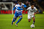 Queens Park Rangers midfielder Bright Osayi-Samuel (20) and Swansea City defender Kyle Naughton (26) compete for the ball during the EFL Sky Bet Championship match between Swansea City and Queens Park Rangers at the Liberty Stadium, Swansea, Wales on 11 February 2020.