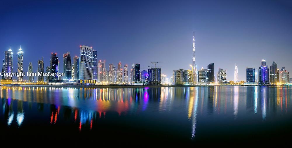 Night view of Burj Khalifa and Creek at new Business Bay district of  Dubai United Arab Emirates
