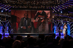 Mo Farah is interviewed via video link alongside children Hussein and Rhianna during the BBC Sports Personality of the Year 2017 at the Liverpool Echo Arena.