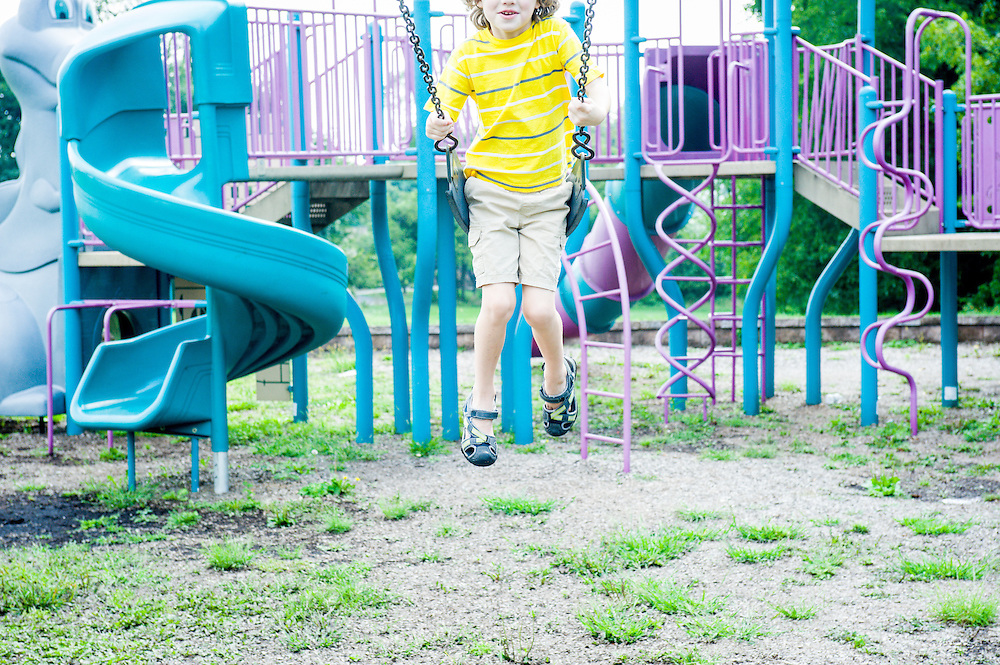 Little boy swings out of frame on playground in Neffs, PA.