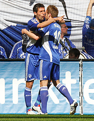 03.04.2010, Veltins Arena, Gelsenkirchen, GER, 1.FBL, Schalke 04 vs Borussia M^nchengladbach, im Bild: 1:0 Torsch¸tze Ivan Rakitic (Schalke - CRO/SUI #10) jubelt mit Kevin Kuranyi (Schalke - GER/BRA #22) ¸ber den Treffer, EXPA Pictures © 2010, PhotoCredit: EXPA/ nph/  Scholz  *** Local Caption *** / SPORTIDA PHOTO AGENCY
