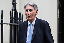 London, UK. 4th December, 2018. Philip Hammond MP, Chancellor of the Exchequer, leaves 10 Downing Street following a Cabinet meeting on the day on which MPs will begin to debate Prime Minister Theresa May's Brexit agreement in the House of Commons.