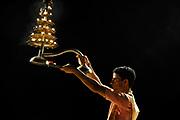 Man performs the nightly Hindu Puja Rituals in Varanasi, Uttar Pradesh, India. Kali puja prayer. The worship of Kali (Hindu Goddess of Time) or Kali puja, at Dhakeswari Temple in Varanasi, Uttar Pradesh, India.
