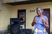 Paula, a local woman, dances at the White House bar near the airport, Sao Tome and Principe<br /> Sao Tome and Principe, are two islands of volcanic origin lying off the coast of Africa. Settled by Portuguese convicts in the late 1400s and a centre for slaving, their independence movement culminated in a peaceful transition to self government from Portugal in 1975.